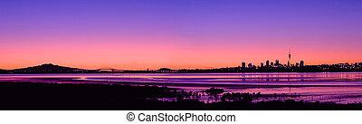 A Panorama of Auckland City, Harbour Bridge and Rangitoto Island at Sunrise