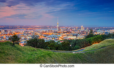 Cityscape image of Auckland skyline, New Zealand taken from Mt. Eden at sunset.