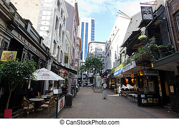 AUCKLAND, NZ - MAY 29:Vulcan Lane on May 29 2013.It?s now a popular cobblestone plaza off Queen St home to fashionable restuarnats, cafes, pubs and stores.