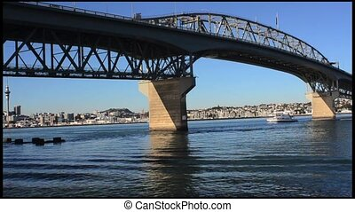 Auckland Harbour Bridge NZL - Ferry sail under Auckland...