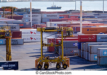 AUCKLAND, NZ - MAY 29:Straddle carriers and containers on Fergusson Wharf at Ports of Auckland on May 29 2013.It's New Zealand's largest commercial port, its turnover of more than NZ$20 billion per year