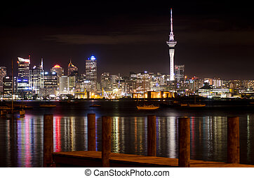 AUCKLAND, NZ - MAY 30:Auckland Skyline at night on May 30 2013.It's the largest and most populous urban area in the country. It has 1,397,300 residents, which is 32 percent of the country's population.