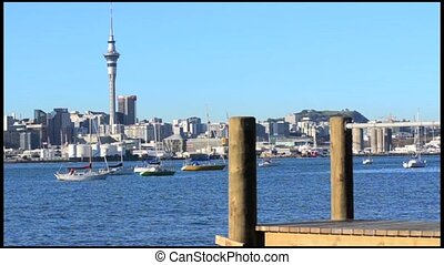 Auckland skyline with a wooden pier - Auckland downtown...
