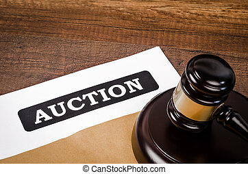 Auction document with wooden gavel.