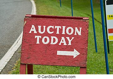Auction Sign - A roadside sign advertizing an auction.