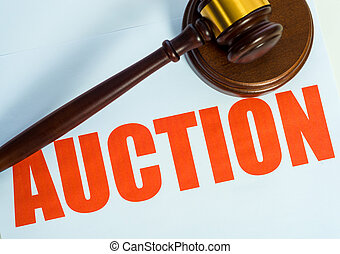 Auction sign and mallet on a white background
