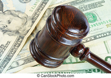 Wood gavel over some bank notes
