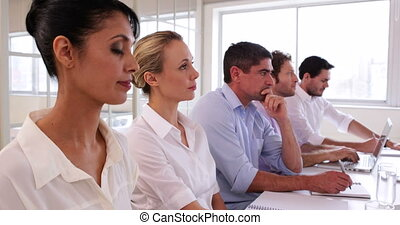 Audience applauding for a presentation in the office