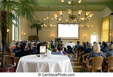 audience at a conference in a classical surrounding