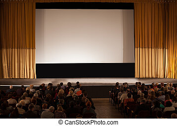 Audience in front of white cinema screen