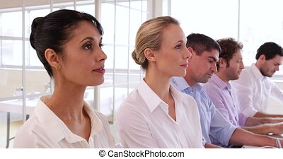 Audience listening to presentation in the office