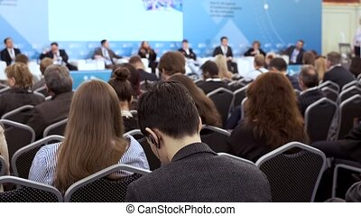 Audience listens to the lecturer at the conference -...