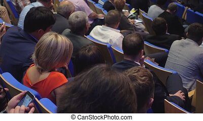 Audience listens to the lecturer - Audience at the...