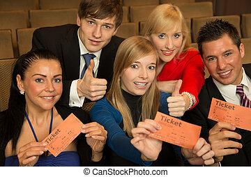 Audience members presenting tickets