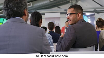 Audience talking at a business presentation