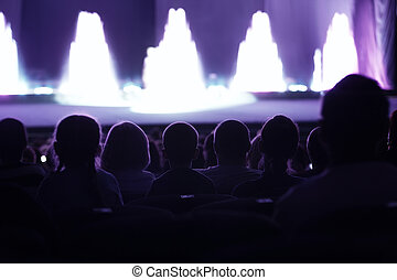 Audience watching a live performance