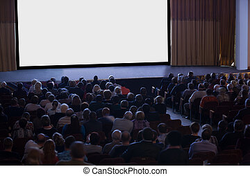 Audience watching cinema - Audience seated in front of an ...