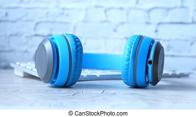 Audio book concept. Headphones and notepad on white background.