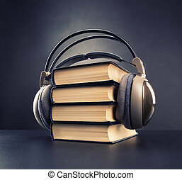 Audio book concept - Black books with headphone on it