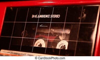 Audio cassette in movement