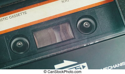 Audio Cassette in Tape Recorder Rewind. Vintage tape...