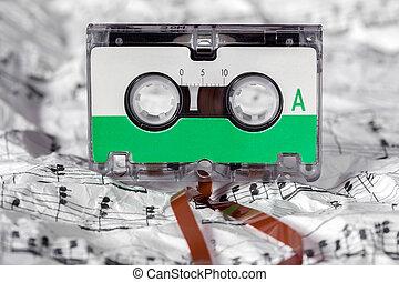 Audio cassette on the music sheet
