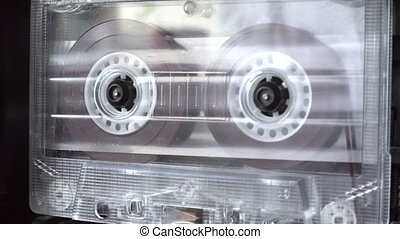 Audio cassette playing old retro tape reels