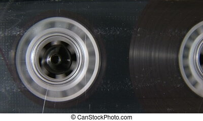 Audio cassette reel playing