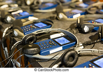 Audio guide with headphones. - Closeup audio guide with...