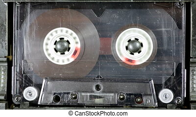 Audio deck playing used transparent Compact Cassette