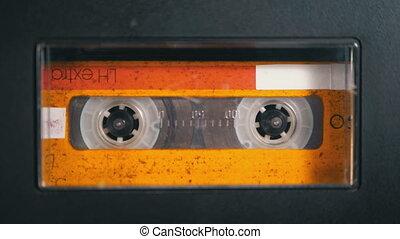 Audio Tape. Vintage Tape Recorder Plays Audio Cassette...
