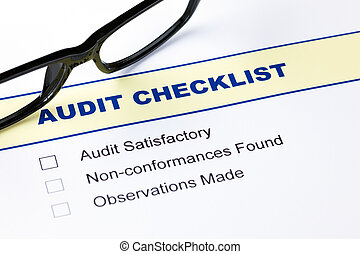 Audit checklist with glasses