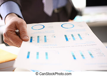 Auditor Calculating Tax Income Using Business Data