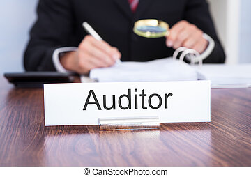 Auditor Looking At Document - Businessman Looking At...