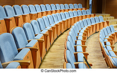 auditorium - rows of blue velvet armchairs in the auditorium