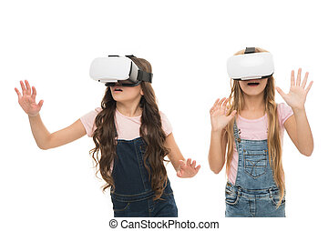 Augmented reality technology. Virtual reality is exciting. Girls little kids wear vr glasses white background. Virtual education concept. Modern life. Interaction in virtual space. Cyber gaming