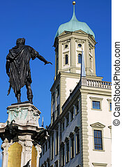 The city house of Augsburg (Bavaria, Germany) with a scuplture of the Augustus fountain in the foreground.