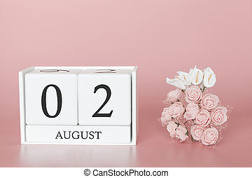 August 02nd. Day 2 of month. Calendar cube on modern pink background, concept of bussines and an importent event.