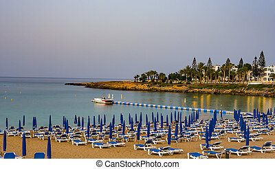 August 2, 2017.Protaras. Chairs with umbrellas on the beach in Fig tree Bay in Protaras .Cyprus.