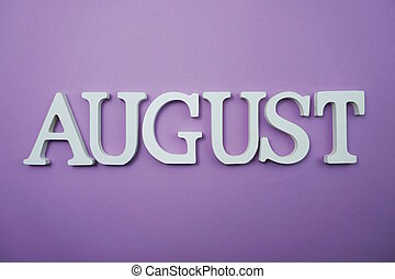 August alphabet letter with space copy on Purple background