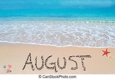 august written on a tropical beach