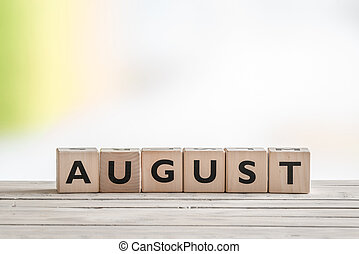 August sign on wooden cubes