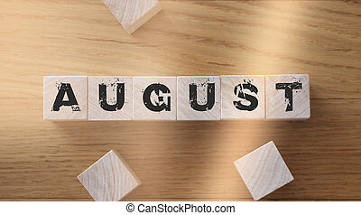 August word written on wood block on wooden table Events schedule concept