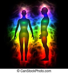 Aura, healing energy, extrasensory perception - woman and man silhouette