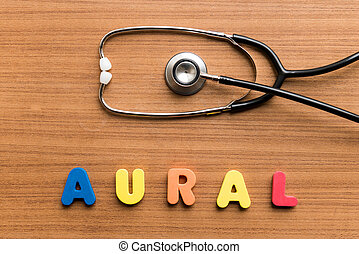 Aural colorful word with Stethoscope on wooden background