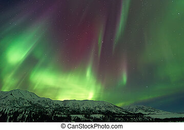 Aurora Borealis above mountains