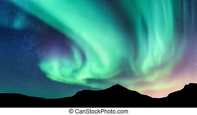 Aurora borealis and silhouette of mountains
