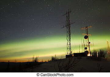 Aurora Borealis and twilight over antenna complex