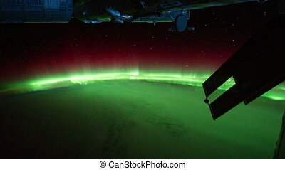 Aurora Borealis as seen from space flight around Earth