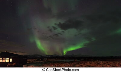 aurora borealis - Iceland is located at the juncture of the...
